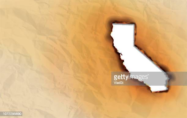 сalifornia wildfire state map burning wrinkled paper on fire - california wildfire stock illustrations
