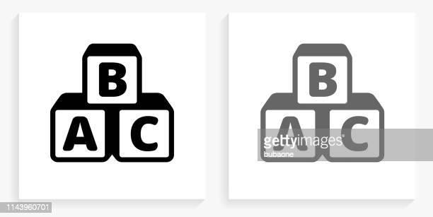 alphabet blocks black and white square icon - building block stock illustrations
