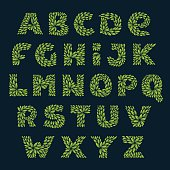 Alphabet icons formed by fresh green leaves.
