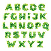 Alphabet icons formed by watercolor fresh green leaves.