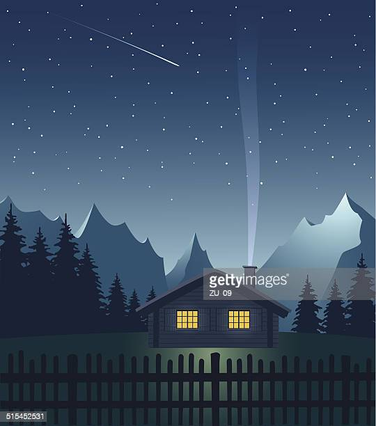 alpine hut in the mountains at night - meteor stock illustrations
