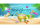 Amazing Songkran Festival summer of Thailand on sea background
