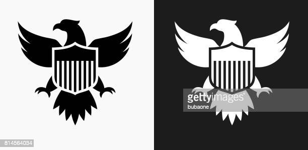 american eagle and shield icon on black and white vector backgrounds - eagle bird stock illustrations, clip art, cartoons, & icons