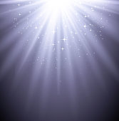 An abstract of a mystical light gleaming down its rays