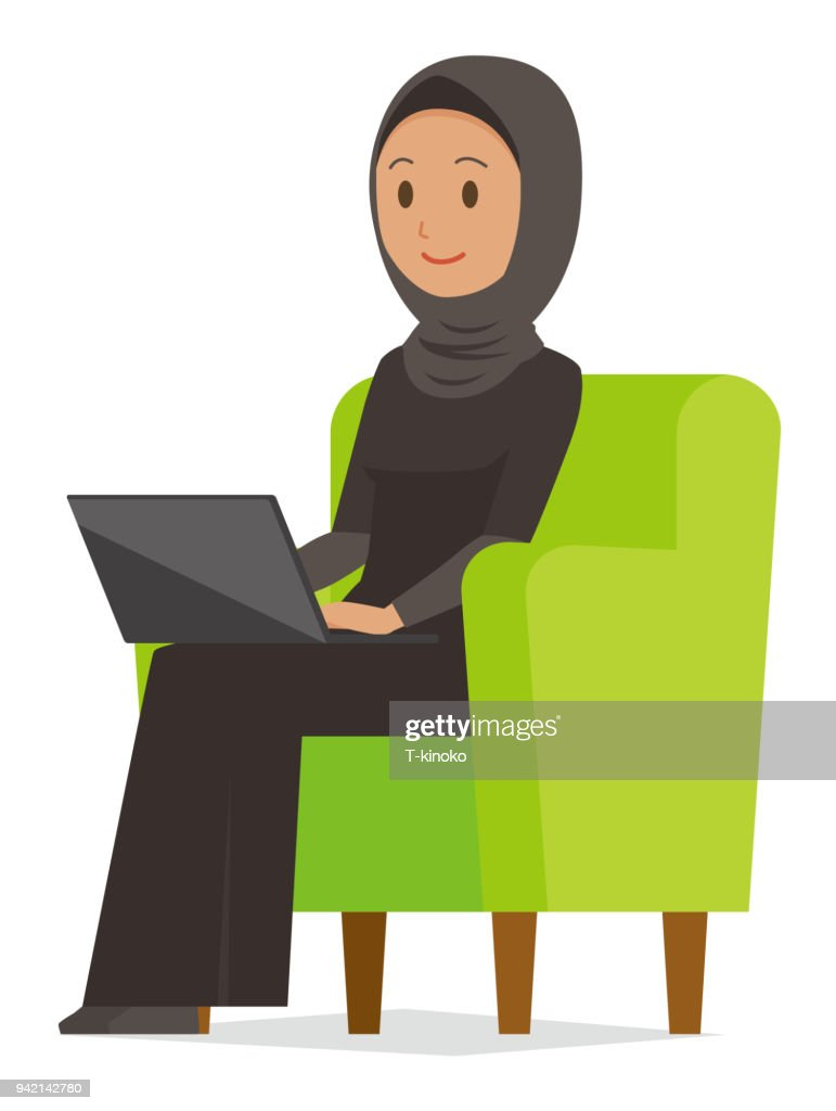 An arab woman wearing ethnic costumes is sitting on a sofa and operating a laptop computer
