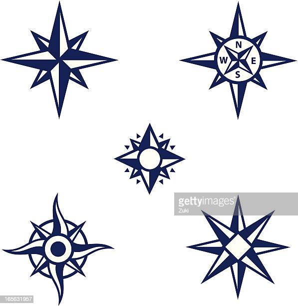 An assortment of dark blue compass symbols