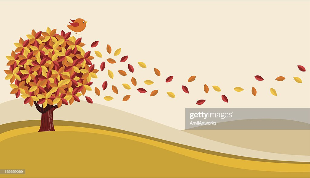 An Autumn tree with the leaves blowing off