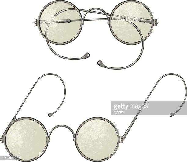 An image of two round lens vintage glasses