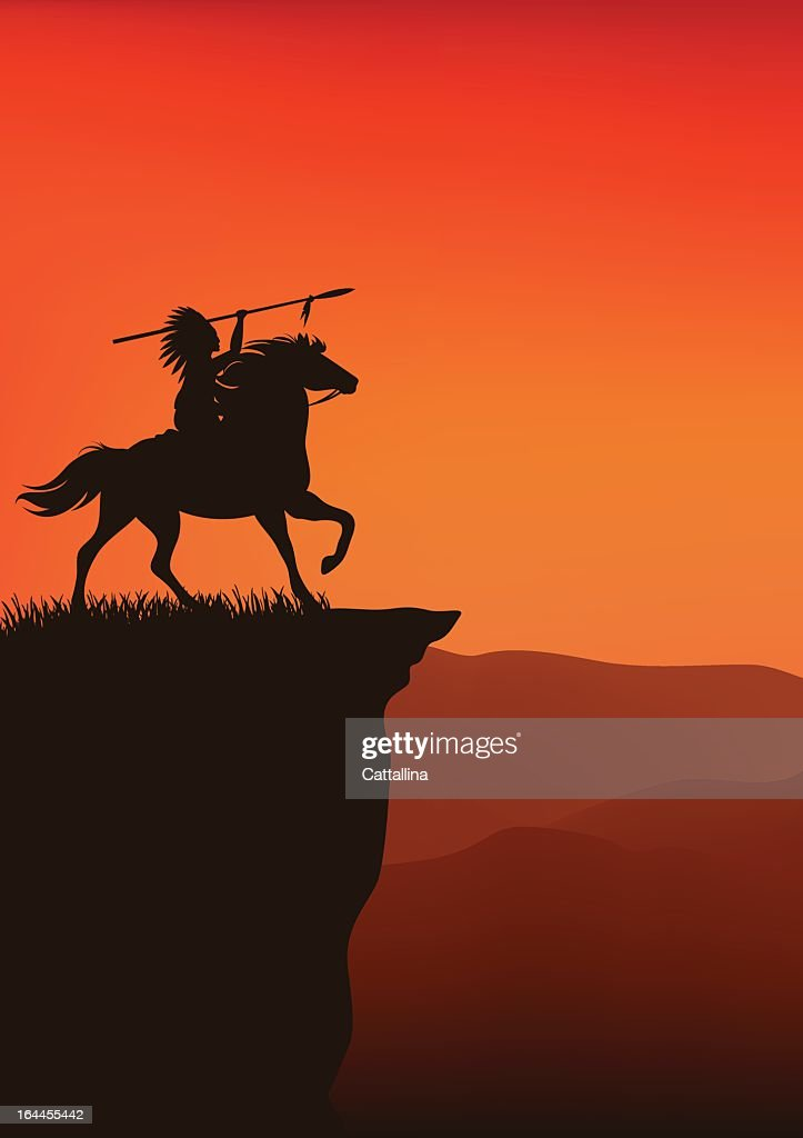 An Indian chief on his horse on the edge of a cliff