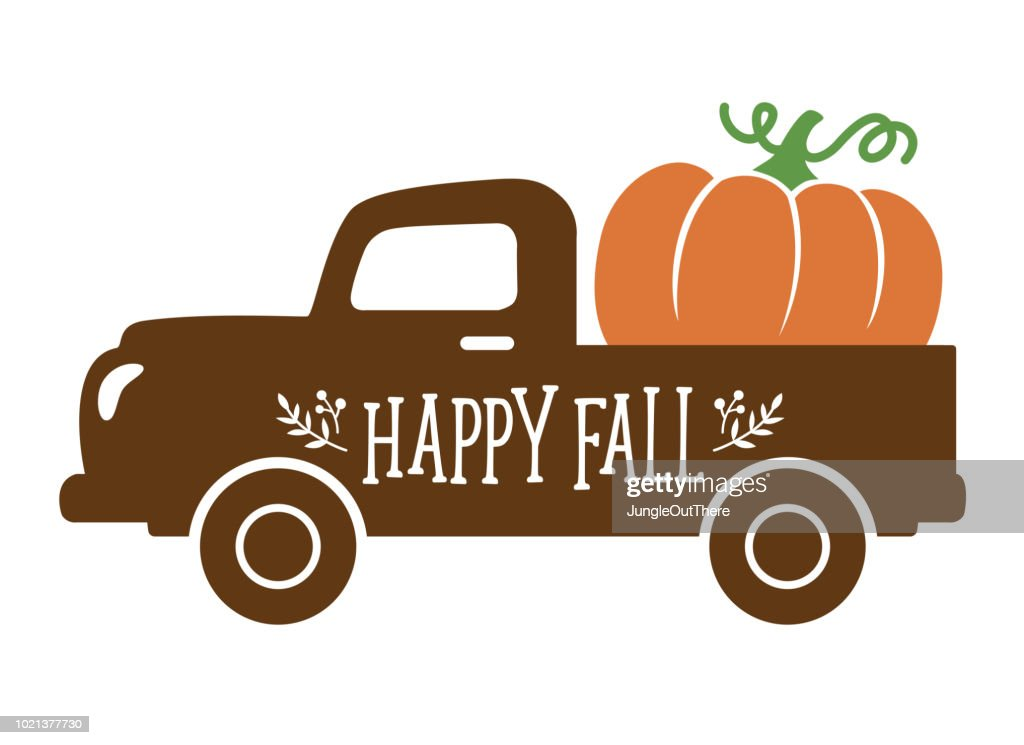 An Old Vintage Truck carrying a Pumpkin in Fall