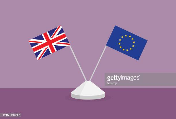 uk and euro flag on a table - vector stock illustrations