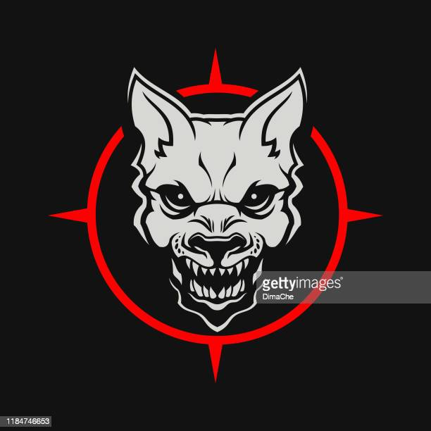angry dog or wolf head cut out silhouette. growling mad dog with open mouth - stylized mascot on a dark background - snarling stock illustrations