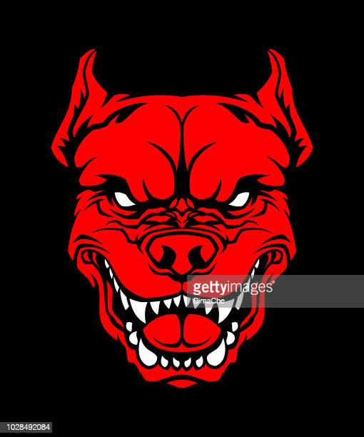 Angry red dog head on black background - pit bull mascot cut out silhouette
