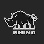 Angry rhino. Monochrome icon on a dark background.