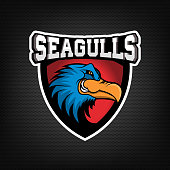 Angry seagull head  on dark background. Sport team