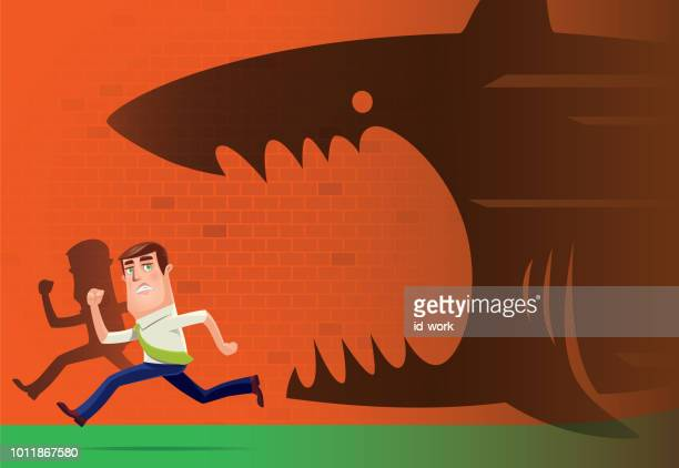 angry shark chasing businessman