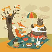 Animals at picnic in autumnal forest