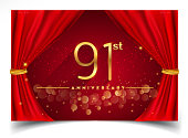 Anniversary design with Glowing Golden Colors Isolated on Realistic Red Curtain