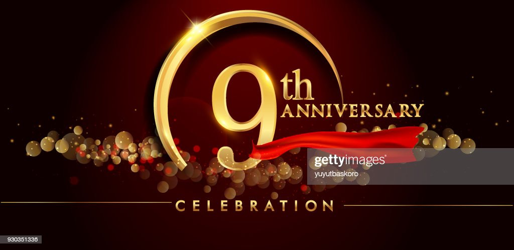 anniversary logo with golden ring, confetti and red ribbon isolated on elegant black background.