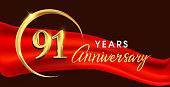 anniversary logotype with golden ring isolated on red ribbon elegant background