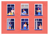 Apartment building with people in open window spaces