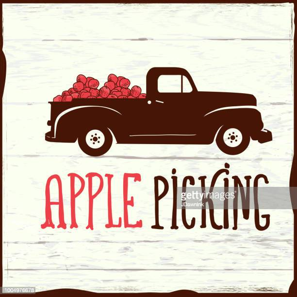 apple picking sign with old fashioned truck on wooden background - harvest festival stock illustrations