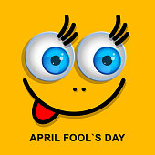 April Fools Day greeting card or background with funny cartoon face.