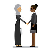 Arab and african american women shake hands