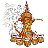 Arabic coffee maker dalla with cups.
