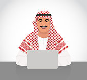 Arabic man working with laptop