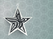 Arabic text in star shape for Eid celebration.