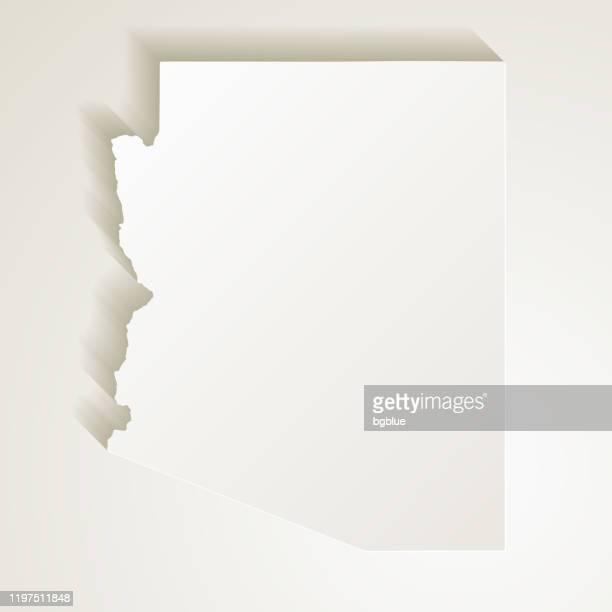 arizona map with paper cut effect on blank background - arizona stock illustrations