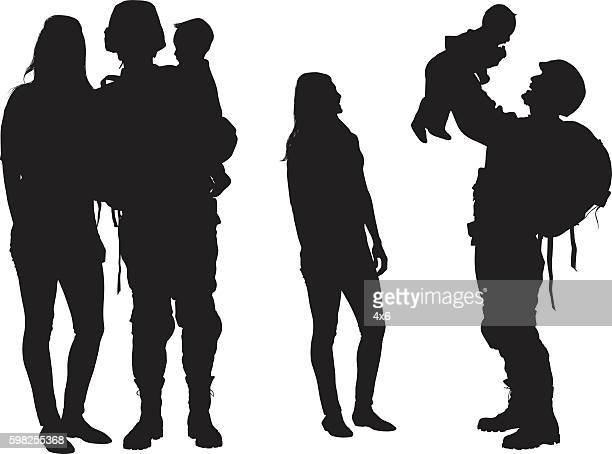 army couple playing with their baby - military stock illustrations