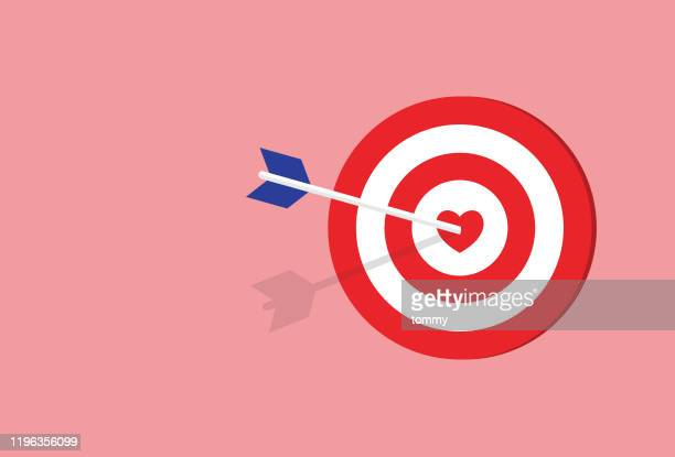 arrow hitting a heart target - beating heart stock illustrations