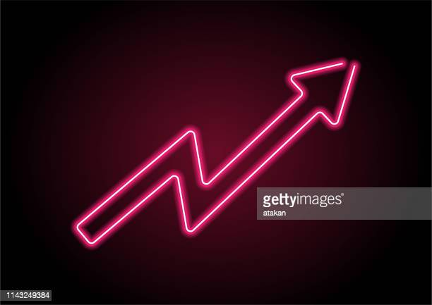 arrow sign red neon light on black wall - moving up stock illustrations