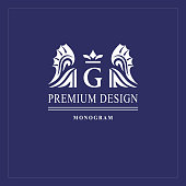Art logo design. Capital letter G. Elegant emblem with crown, dragon wings. Beautiful creative monogram. Graceful sign for Royalty, business card, Boutique, Hotel, Heraldic. Vector illustration