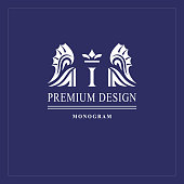 Art logo design. Capital letter I. Elegant emblem with crown, dragon wings. Beautiful creative monogram. Graceful sign for Royalty, business card, Boutique, Hotel, Heraldic. Vector illustration