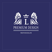 Art logo design. Capital letter L. Elegant emblem with crown, dragon wings. Beautiful creative monogram. Graceful sign for Royalty, business card, Boutique, Hotel, Heraldic. Vector illustration