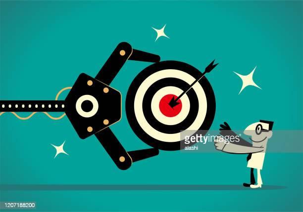 ilustrações de stock, clip art, desenhos animados e ícones de artificial intelligence robot arm gives a businessman a dartboard (goal, target) that has an arrow on the bull's-eye - nicho