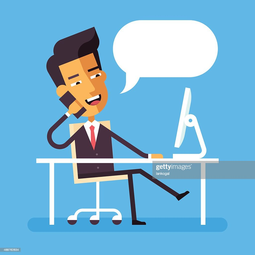 Asian businessman sitting at the desk with phone