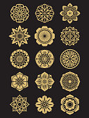 Asian flowers icons set isolated on black background. Chinese or japanese decorative elements