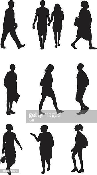 Assorted people walking
