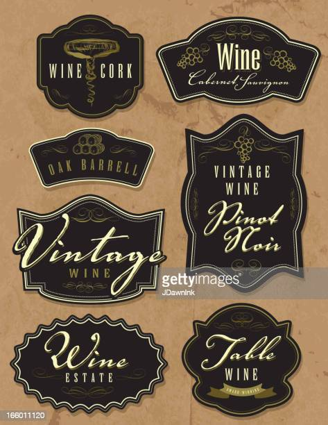assorted vintage wine bottle labels on paper background - cabernet sauvignon grape stock illustrations