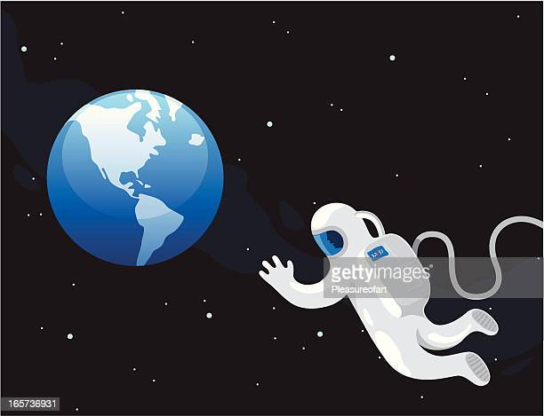 Astronaut in spacesuit looking at planet earth