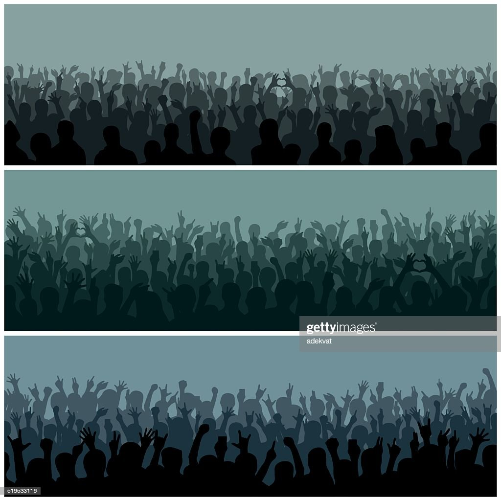 Audience with hands silhouette raised music festival and concert streaming