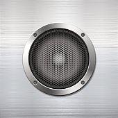 Audio speaker on metallic background.