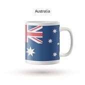 Australia flag souvenir mug on white background.