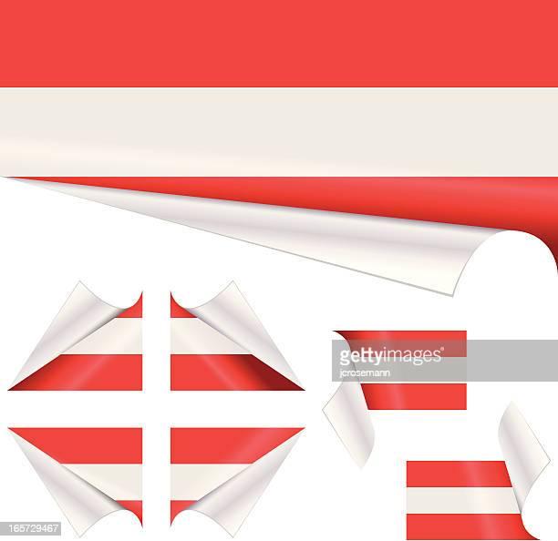 Österreichische Flagge hinter gelockter Papier