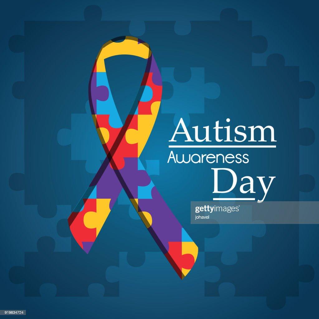 autism awareness day puzzle shape ribbon blue background