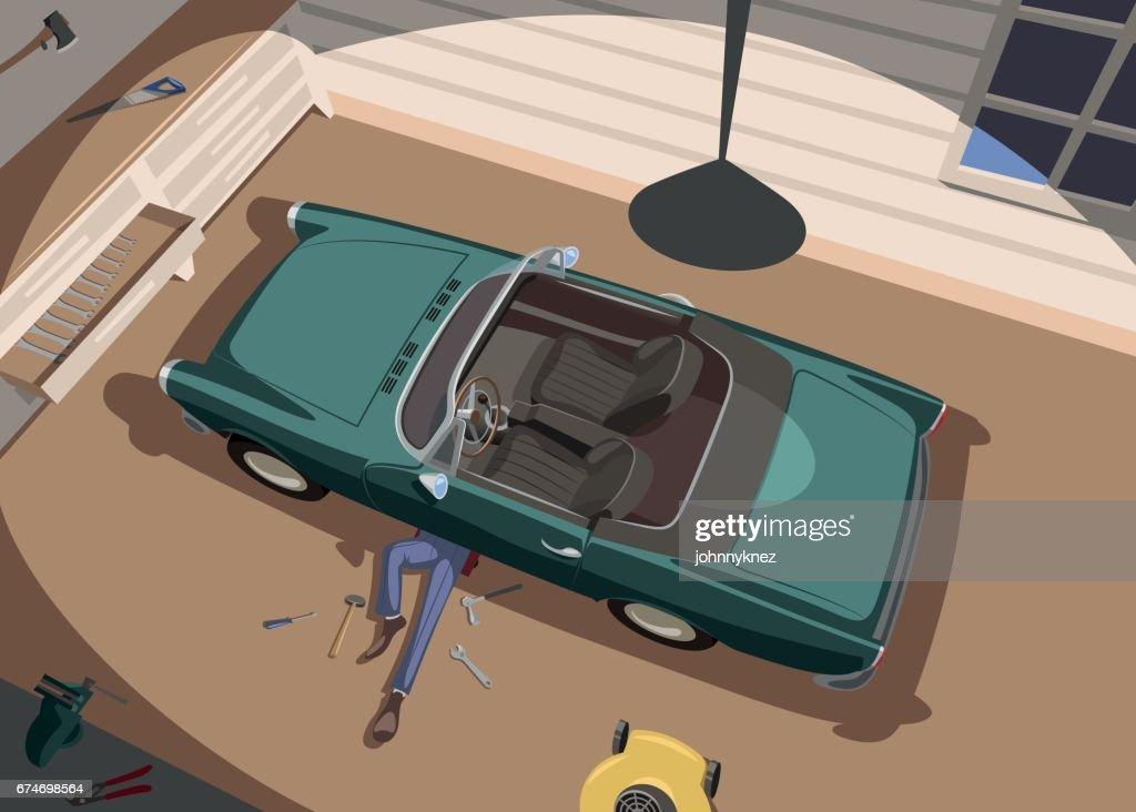 Auto mechanic repairs his car in the garage